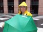 Jean with umbrella and raincoat at a climate demonstration
