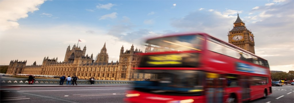 A London bus travelling past the Houses of Parliament