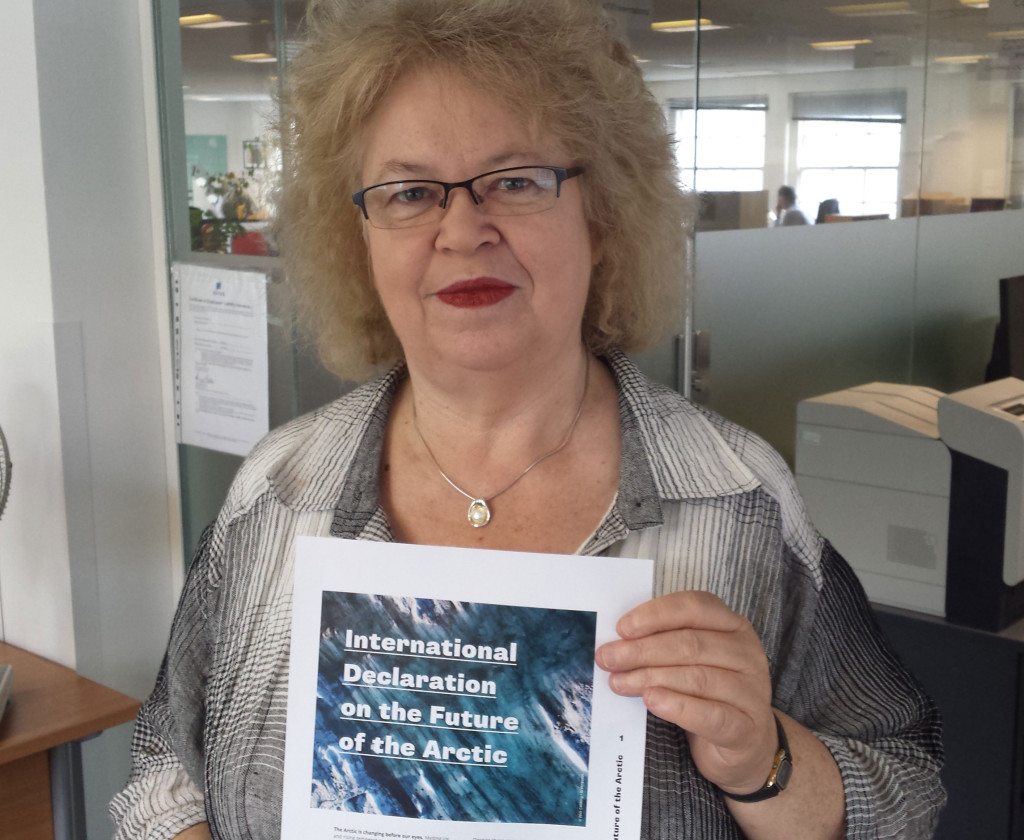 Jean holding the International Declaration on the Future of the Arctic