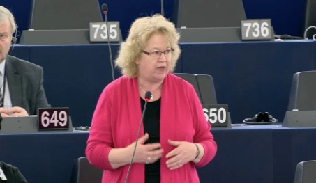 Jean speaking in a debate on human rights breaches