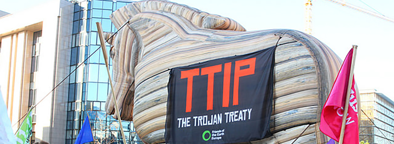 A trojan horse outside the European Parliament with banner 'TTIP the Trojan Treaty'